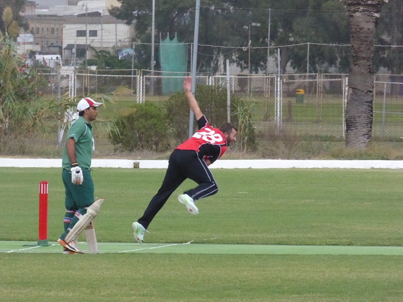 Andrew Naudi bowling during his 50th International for Malta